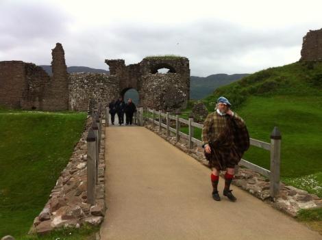 Walking over Urquhart Castle's moat